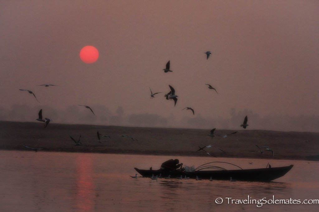 A boat at sunrise in Ganges River, Varanasi India