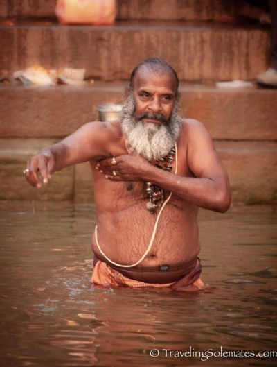 A man bathing in Ganges River, Varanasi, Indai