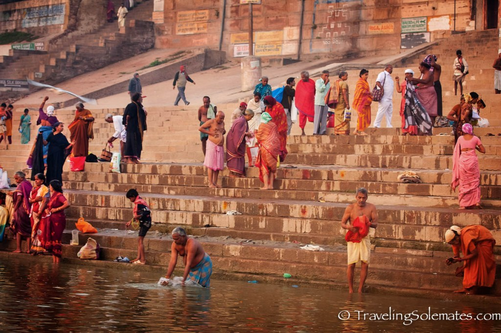 People descending the ghat into Ganges River, Varanasi India