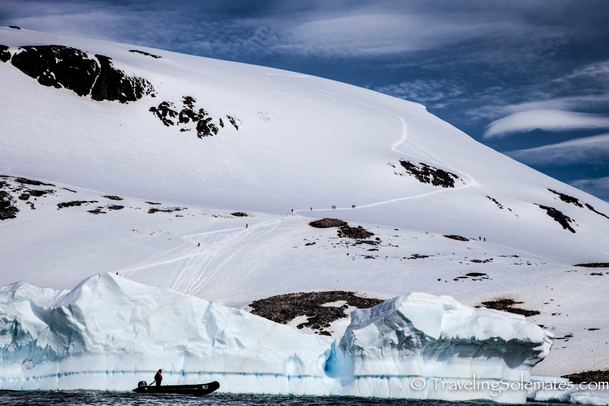 People hiking in glaciered mountain in Antartica