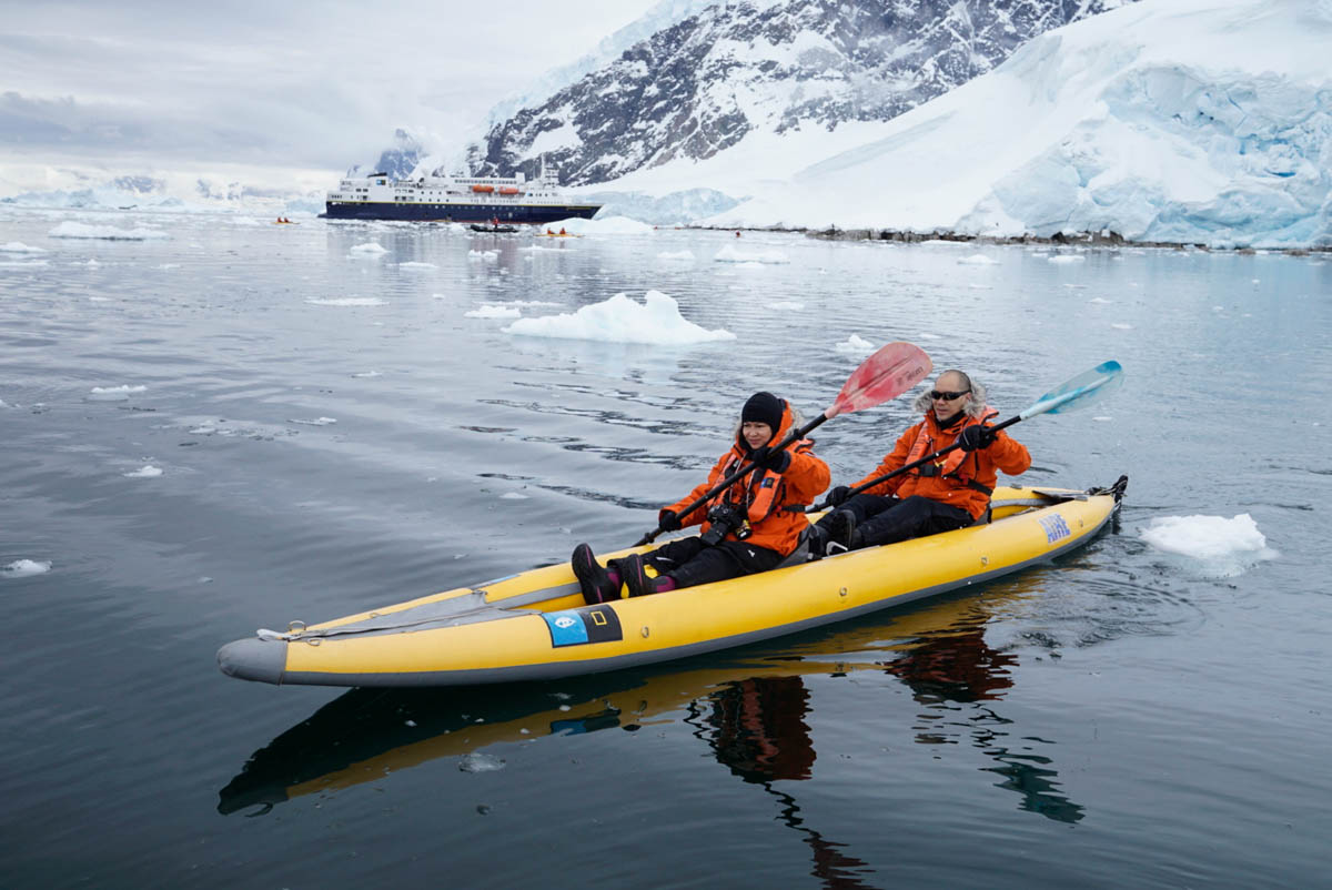 People Kayaking in Antartica