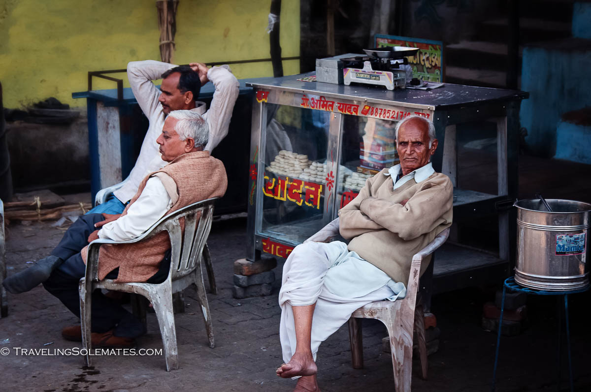 Men sitting by the in town square, Orchha, India