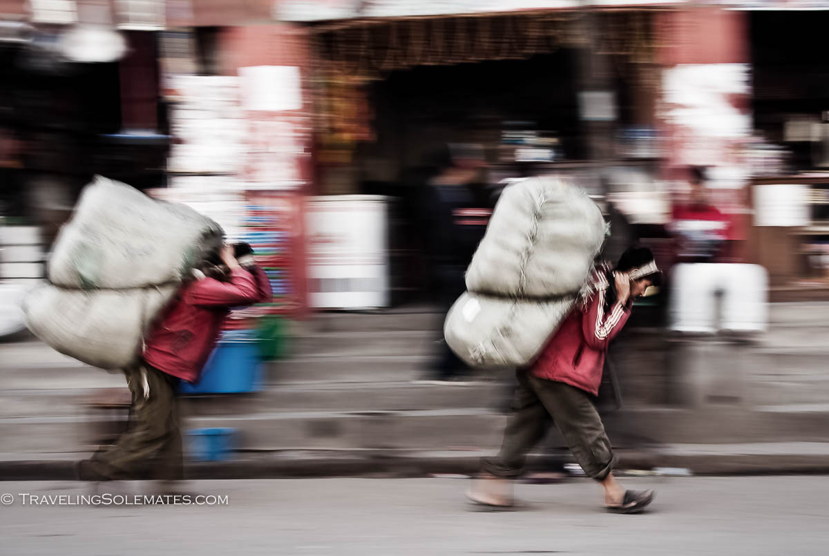 Men carrying heavy load on their back, Kathmandu, Nepal