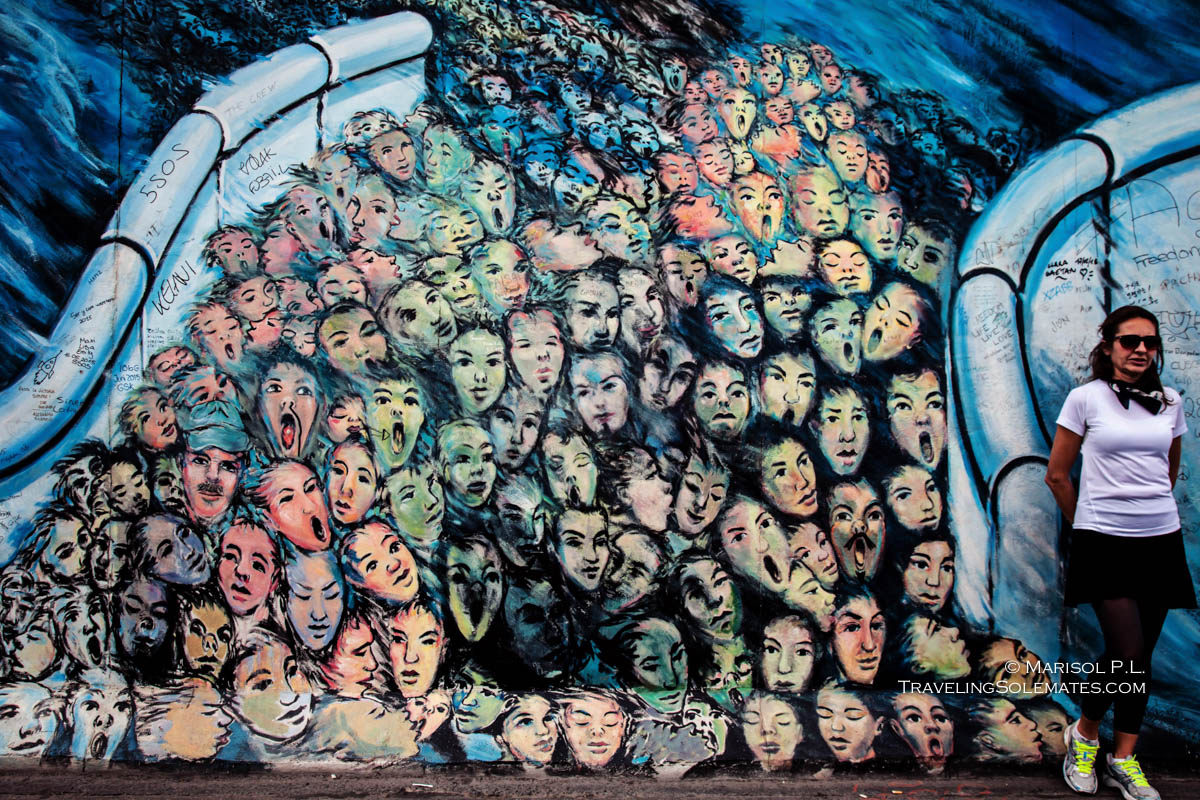 The murals on berlin wall 39 s east side gallery traveling for A mural is painted on a