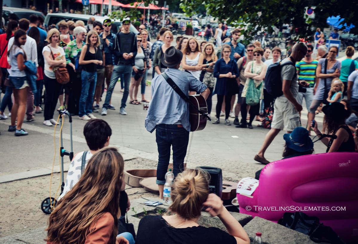 People watching a musician playing in Mauerpark, Berlin, Germnany