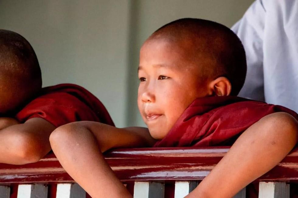Novice monk watching festivities, Myanmar