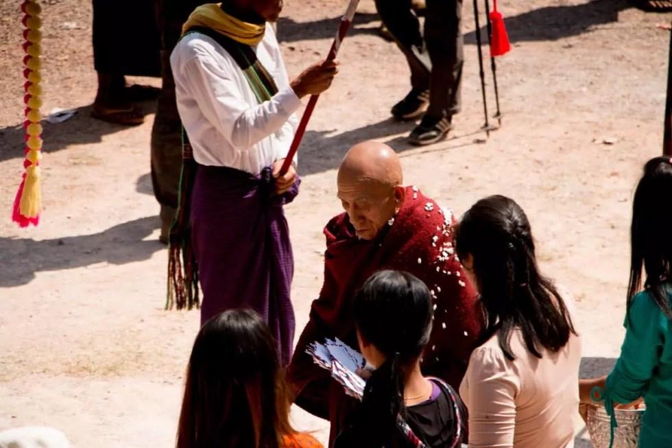 Elder monk giving a blessing, Myanmar