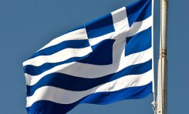 Flag of Greece flying over the Acropolis