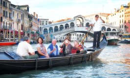 Gliding the Canals of Venice in an Iconic Gondola