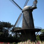 A small child runs beneath the giant Wilhelmina Windmill in San Francisco's Golden Gate Park