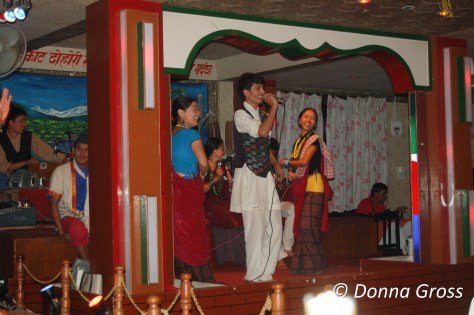 "Musicians performing and ""story telling"" in a Kathmandu disco"