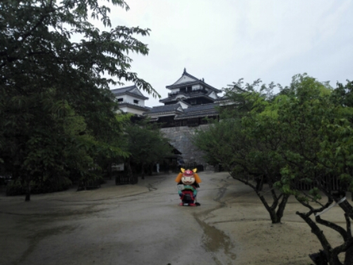 View of Matsuyama Castle and weird doll