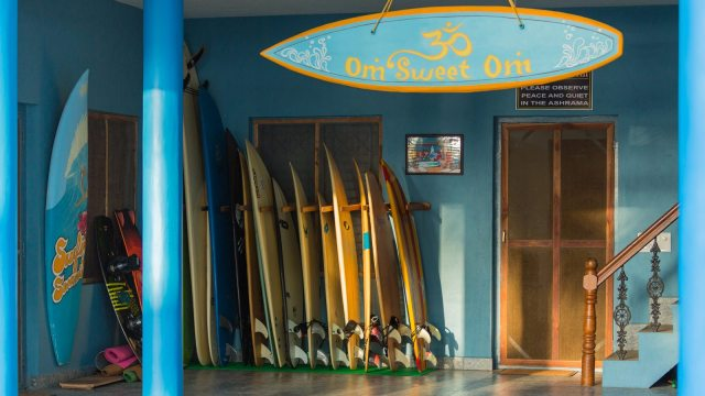 Many surfboards stacked for the guests, while one hangs in the verandah flaunting Ashram's meditative lifestyle