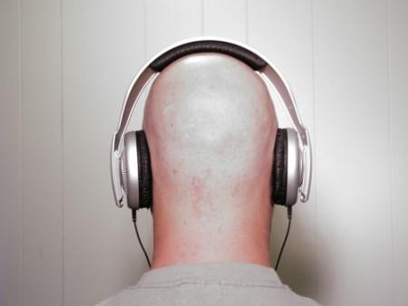 Bald man wearing Headphones 2 by dead-stock via deviant-art.com