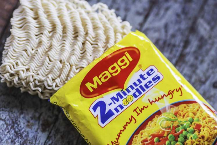 An open packet of Maggi 2-Minute Noodles, manufactured by Nestle India Ltd., are arranged for a photograph inside a general store in Mumbai, India, on Tuesday, June 2, 2015. Nestle, one of India's biggest processed food makers, slid to the lowest in a month after a complaint was filed in a local court over lead levels in its Maggi instant noodles. Photographer: Dhiraj Singh/Bloomberg via Getty Images