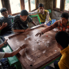 Boys play a game of carrom in Khati