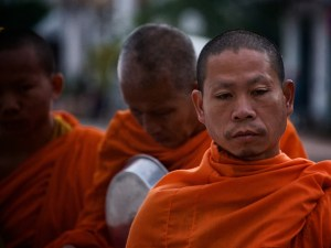 Monks in the procession at dawn in Luang Prabang, Laos