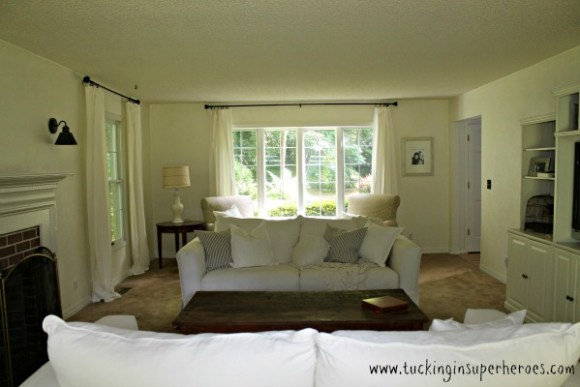 white slipcovered couch farmhouse www.tuckinginsuperheroes.com