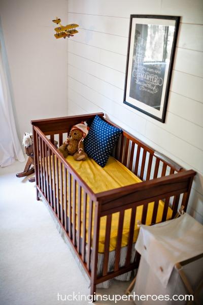 Nursery Crib Tucking In Superheroes