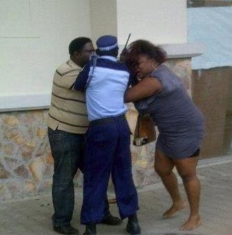 Photo: Woman In Blow Exchange With Hubby In Public