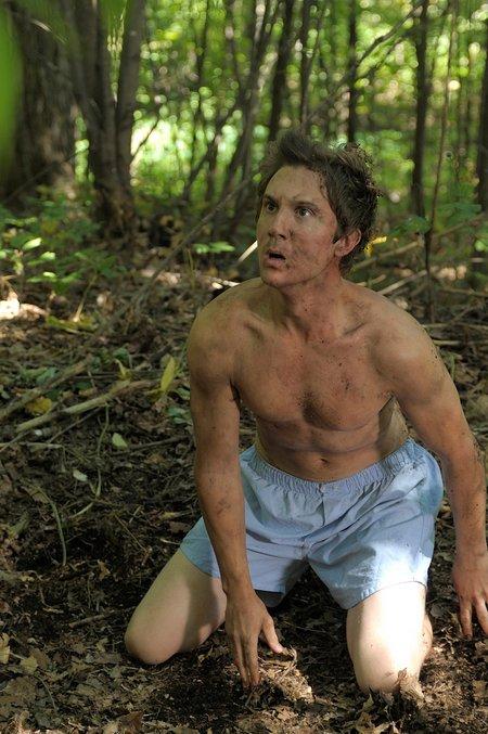 josh kneeling in woods 1