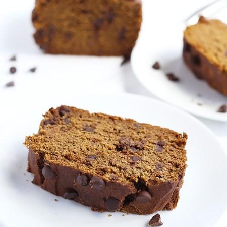 This Vegan Gluten Free Pumpkin Spice Bread is moist, soft and delicious! Chocolate chips are added for extra sweet-ness in this bread! / TwoRaspberries.com