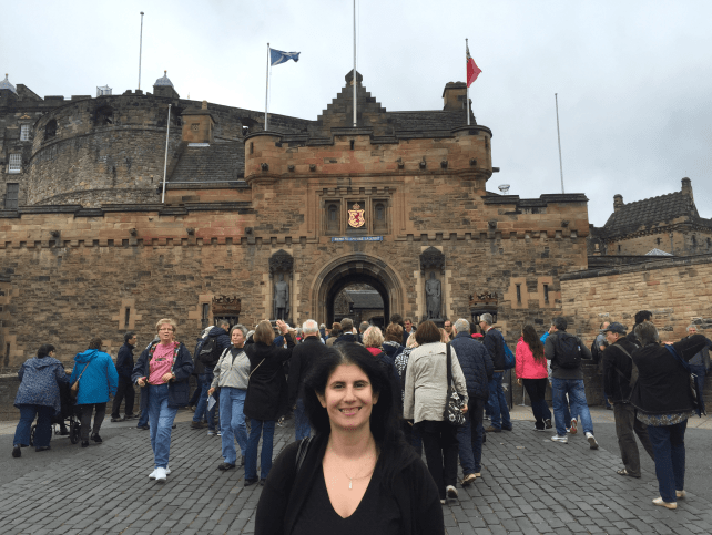 """Anisa in front of the entrance to Edinburgh Castle. - """"Experiencing History at Edinburgh Castle"""" - Two Traveling Texans"""