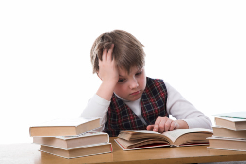 young studiing boy isolated on white backgroung