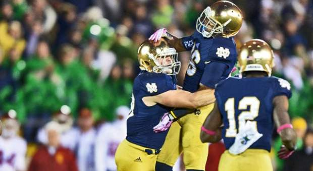 Notre Dame's Joe Schmidt and Cole Luke celebrate Schmidt's big play against the Trojans in 2013.  Can the Irish beat the USC for a 3rd year in a row in 2014?  (Photo:  Kirby Lee / USA TODAY Sports)