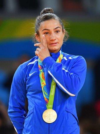 Majlinda Kelmendi wipes away a tear on the podium
