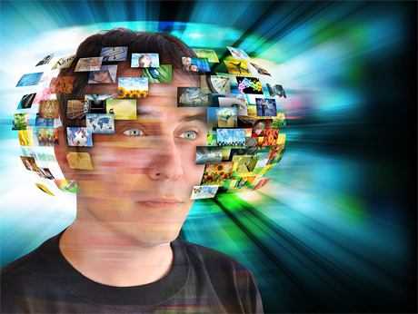 man with information screens spinning around head
