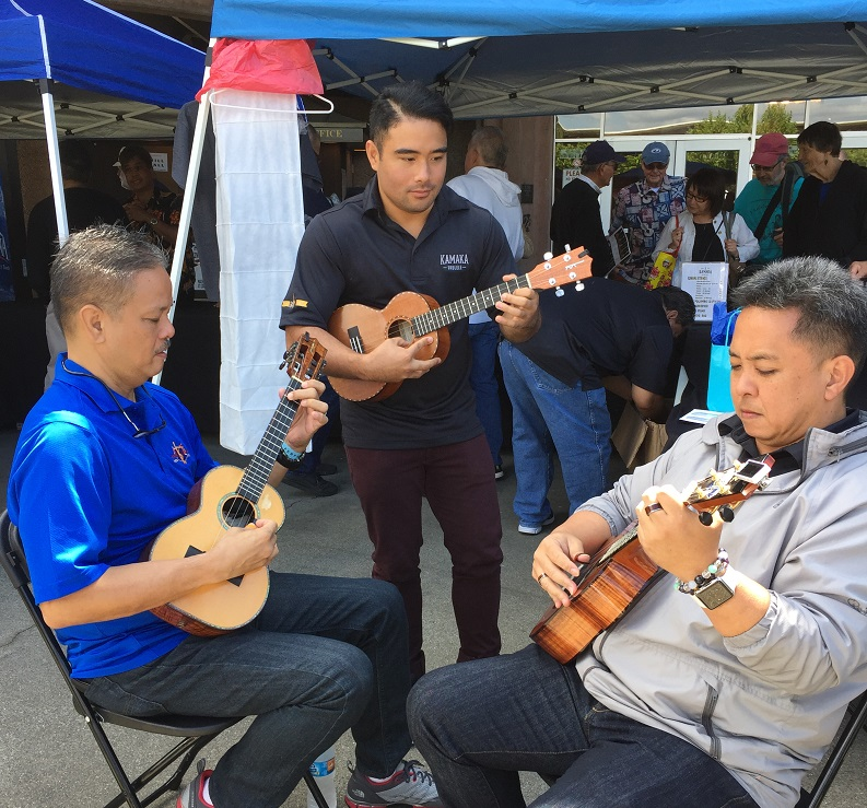 Generations of great player making music. Bryan Tolentino (L), Kalei Gamiao, and Herb Ohta Jr jamming at the Ukulele Festival of Northern California.