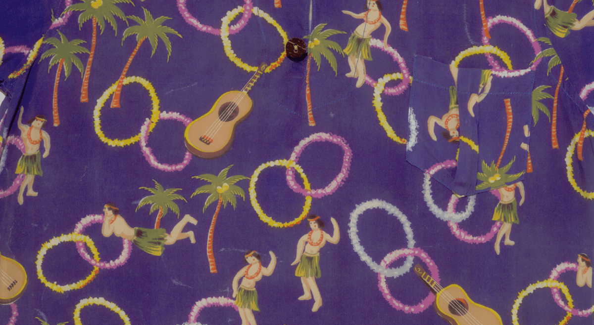 Coconut buttons, stylized leis, hula dancers, and ukuleles from pre-statehood Hawaii.