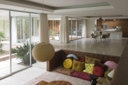 simple sunken corner living room design with floor seating