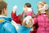 Playing snowball fight