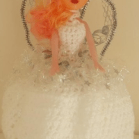 The Old Doll Cover on the Toilet Roll Trick
