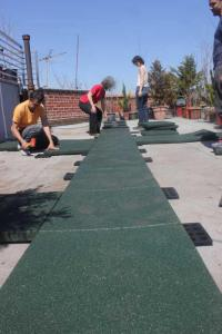 installing recycled rubber pavers on roof