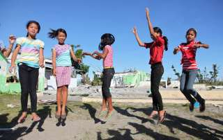 Girls play in the schoolyard at Santo Niño Elementary School in the town of Tanauan, Philippines. Photo: UNICEF/Giacomo Pirozzi
