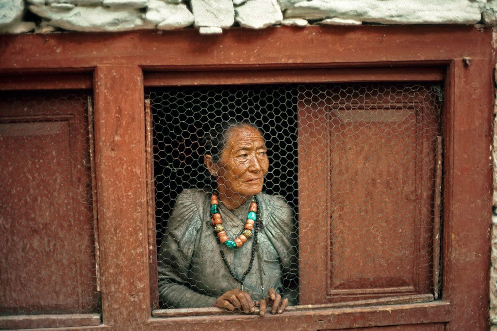 Photo: An old woman at her window in a Nepalese village. UN Photo/John Isaac