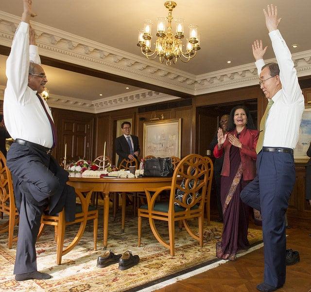 Photo: Secretary-General Ban Ki-moon gets a yoga lesson from Vijay Nambiar, the Secretary-General's Special Adviser on Myanmar. UN Photo/Mark Garten.
