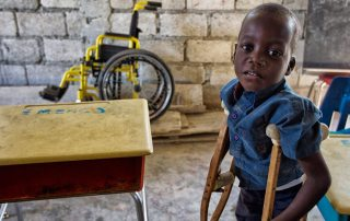 Photo: A young student at a school for disabled children in the poor neighborhood of Cité Soleil in Port-au-Prince, Haiti. UN Photo/Logan Abassi