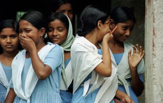 Photo: Students laugh as they leave school in Bangladesh. Photo: Scott Wallace/World Bank