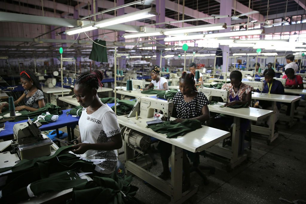 Photo: Young factory workers producing shirts in Accra, Ghana.
