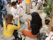 Photo: Young people participate in a contest about building with sustainable materials.