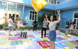 "Young people play an ""HIV knowledge"" board game at an event to promote sexual and reproductive health among adolescents supported by the China Center for Health Education and UNICEF China. Photo: UNICEF/Xia Yong"