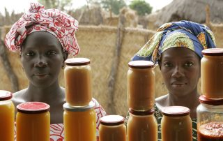 Photo: Women sell mango and sweet potato jam at the food processing shop in Bantantinnting, Senegal.