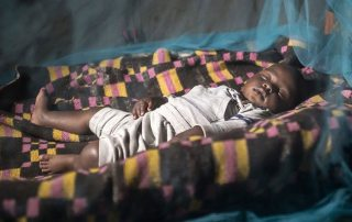 More than 50 per cent of people at risk of malaria in Africa are now sleeping insecticide-treated nets. Photo: WHO