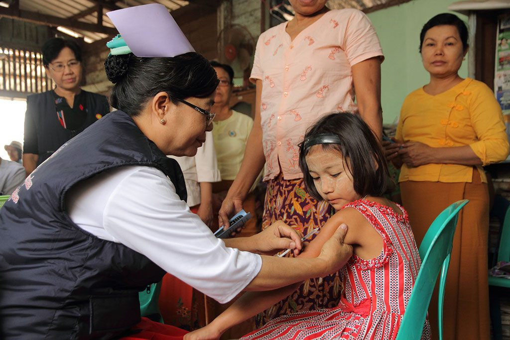 A child being vaccinated in a vaccination post established in Hlaing Thar Yar Township, Yangon, Myanmar Photo: UNICEF/ Thame
