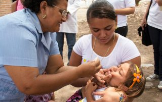 A child in Honduras being dewormed. Photo: Sabin Institute/PAHO/WHO