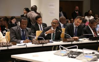 Rwandan President Paul Kagame speaks about the need for empowering women and girls. To the left is Abdallah Albert Toikeusse Mabri, foreign affairs minister of Cote d'Ivoire. Behind him is UN Secretary-General's Envoy for Youth Ahmad Alhendawi. © UNFPA/Koye Adeboye